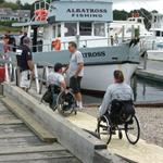 Members assisting Wounded Heroes on the Albatros