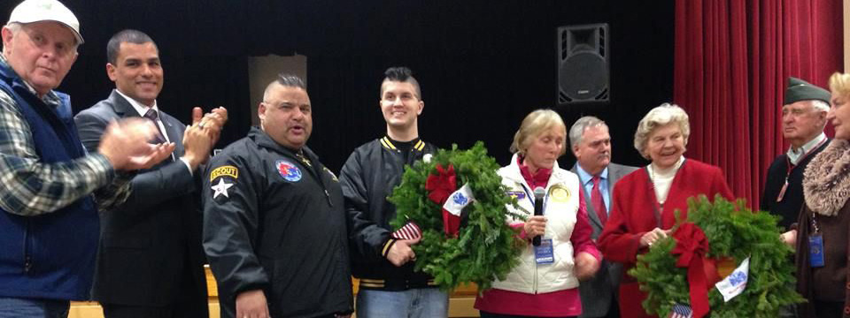 Members Vincent Manion Brodeur, with wreath, (Father Jeff on his left) with our friends at Wreaths Across America.